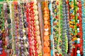Beads many women s of colored natural stones Royalty Free Stock Photo