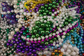 Beads mardi gras mixed up together in a group Royalty Free Stock Photography