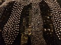 Beads and sequins gold silver on a black background Royalty Free Stock Image