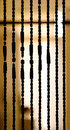 Beads silhouette wood beaded curtain Royalty Free Stock Photography