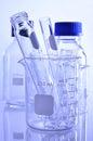 Beaker and tube on white background. Stock Image