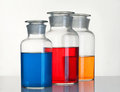 Beakers three with a reagents are on the table Royalty Free Stock Photo