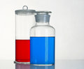 Beakers two with a reagents are on the table Royalty Free Stock Photos