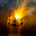 Beam of fire blaze burst out from internal can in the act golden aluminium Stock Photography