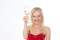 Beaming nordic girl having a toast smiling celebrating something with glass of white wine Stock Photos