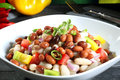 Bean salad in white ceramic on colorfull background Stock Image
