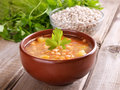 Bean soup in ceramic bowl on wooden table Stock Photo