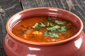 Bean soup and parsley on the table with in a clay bowl Royalty Free Stock Image