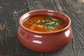 Bean soup and parsley on the table with in a clay bowl Stock Photography