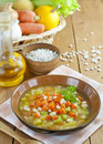 Bean soup with pumpkin in brown bowl on the table Stock Photo