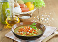 Bean soup with pumpkin in brown bowl on the table Royalty Free Stock Photo