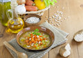 Bean soup with pumpkin in brown bowl on the table Stock Image