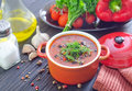 Bean soup in red bowl Stock Photo