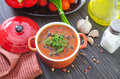 Bean soup in red bowl Stock Photos