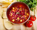 Bean soup with rosemary on wooden table Stock Images