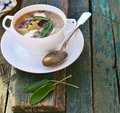 Bean soup with sage leaf in to white table Royalty Free Stock Photo