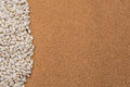 Beans bordering on side background border the of a neutral colored cork Royalty Free Stock Photo