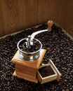 Beans of coffee and coffee grinder fresh grinded on wooden background Stock Photos