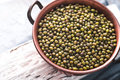 Beans in a copper bowl on a white stand Royalty Free Stock Photo