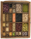 Beans, grains, seeds in vintage typesetter box Royalty Free Stock Photography