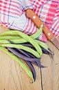 Beans green and purple on board asparagus napkin knife background wooden plank Stock Image