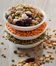 Beans and lentil on a wooden table selective focus Stock Images