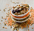 Beans and lentil on a wooden table selective focus Royalty Free Stock Images