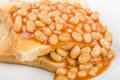 Beans on toast slices of toasted white bread buttered and topped with baked simple british breakfast meal Stock Photo