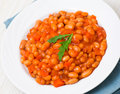 Beans with vegetables on plate Stock Photo