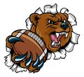 Bear and American Football Ball Tearing Background Royalty Free Stock Photo