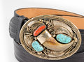 Bear claw and turquoise belt buckle gold coral with snakeskin Royalty Free Stock Photo