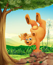 A bear doing a handstand near the tree Royalty Free Stock Image
