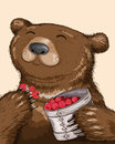 Bear eating raspberries funny from basket Royalty Free Stock Image