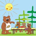 Bear family lunch cubs eating at a table in nature Royalty Free Stock Photos