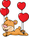 Bear flying with balloons in the shape of heart