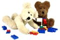 Bear friends with colorful blocks two fuzzy teddy bears share plastic building while they play toys isolated on a white background Stock Photography