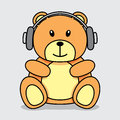 Bear with headphones little brown teddy listening to music Stock Photo