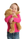 Bear hug little toddler girl giving a bu to a teddy Royalty Free Stock Photo