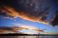 Bear lake sunset orange clouds with blue skies hover over Royalty Free Stock Photos