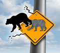 Bear market decline business and finance concept for wealth growth as a yellow traffic sign with a bull icon breaking out of the Royalty Free Stock Image