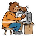 Bear repairing a TV Royalty Free Stock Photo