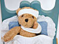 Bear in Sick Bed Royalty Free Stock Photography