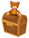 A bear at the top of a treasure chest illustration on white background Stock Photos