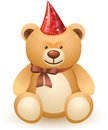 The bear toy with a bow and festive cap on white background Royalty Free Stock Photo