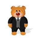 Bear toy in coat vest and trousers on a white background Royalty Free Stock Photography