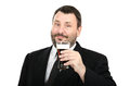 Bearded clerk holds a ale glass in black suit on white background Stock Photos
