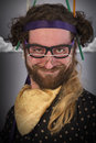 Bearded crazy person lunatic wearing several pairs of glasses Stock Photography