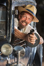 Bearded gangster shooting from car man firing submachine gun vintage s Stock Photo