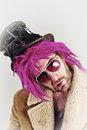 Bearded lunatic pink haired bum man with cool sunglasses Stock Photo