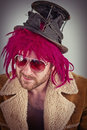 Bearded lunatic pink haired bum man with cool sunglasses Royalty Free Stock Photos